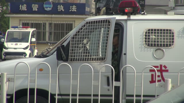 exterior driving shots around tiananmen square, beijing, with a heavy police presence on the eve of the 25th anniversary of the tiananmen square... - tiananmen square massacre stock videos & royalty-free footage