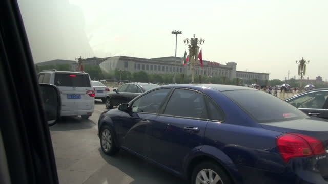 exterior driving shots around tiananmen square on the eve of the 25th anniversary of the massacre, with a heavy police and military presence in... - tiananmen gate of heavenly peace stock videos & royalty-free footage