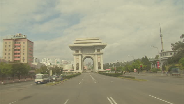 exterior driving shots through pyongyang, passing the triumphal arch and kumsusan palace of the sun on october 11, 2015 in pyongyang, north korea. - korean war stock videos & royalty-free footage