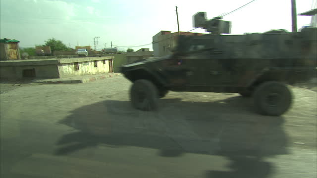 exterior driving shots through silopi past a pall of smoke on the syrian side of the border and turkish soldiers and armoured vehicles at the... - silopi stock videos and b-roll footage