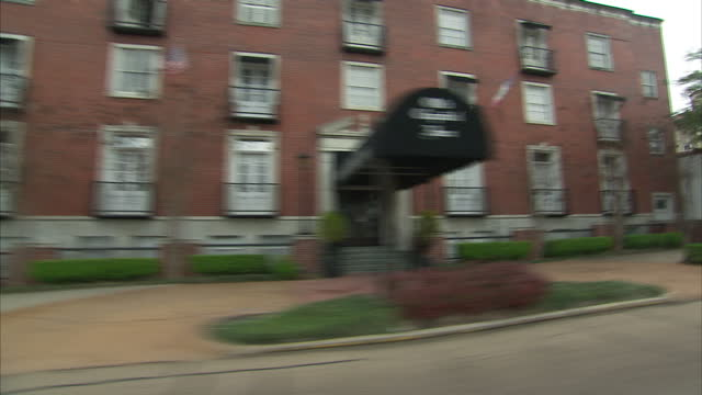exterior driving shots through the streets of jackson mississippi past businesses and residential homes on 21 february 2017 - jackson stock videos & royalty-free footage