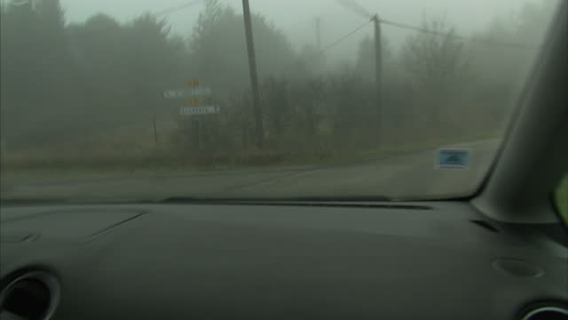 Exterior driving shots through thick fog towards Mount Bugarach on December 21 2012 in Bugarach France