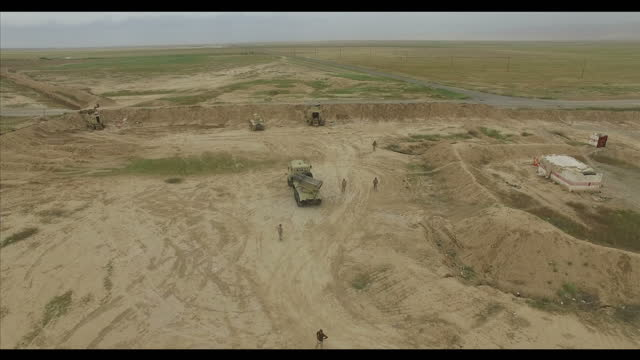 exterior drone aerial shots in erbil of kurdish peshmerga military positions and defences on may 31, 2016 in mosul, iraq. - isis stock-videos und b-roll-filmmaterial