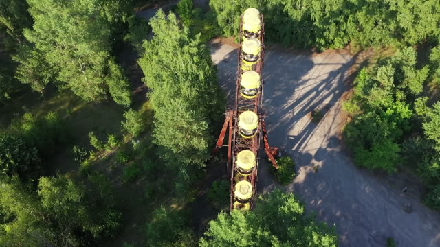 exterior drone aerial shots of a derelict fairground with ferris wheel in the abandoned city of pripyat, on 12 june 2019 in pripyat, ukraine - ukraine stock videos & royalty-free footage