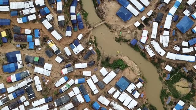 exterior drone aerial shots of a huge sprawling refugee camp in bangladesh near the border with myanmar home to half a million displaced rohingya... - myanmar stock videos & royalty-free footage