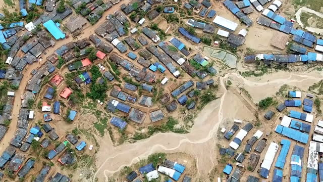 exterior drone aerial shots of a huge sprawling refugee camp in bangladesh near the border with myanmar home to half a million displaced rohingya... - exile stock videos & royalty-free footage