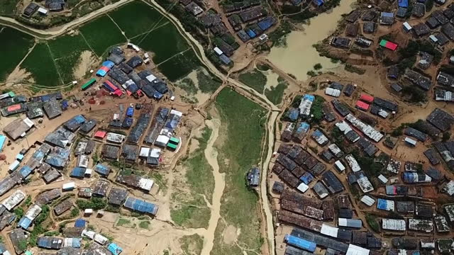 Exterior drone aerial shots of a huge sprawling refugee camp in Bangladesh near the border with Myanmar home to half a million displaced Rohingya...