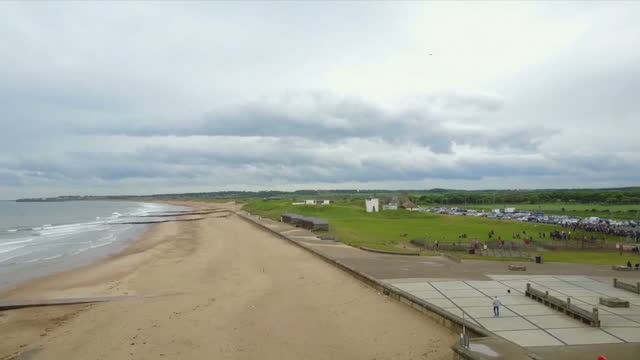 exterior drone aerial shots of an empty blyth beach on a rainy day in northumberland united kingdom - northumberland coast stock videos & royalty-free footage