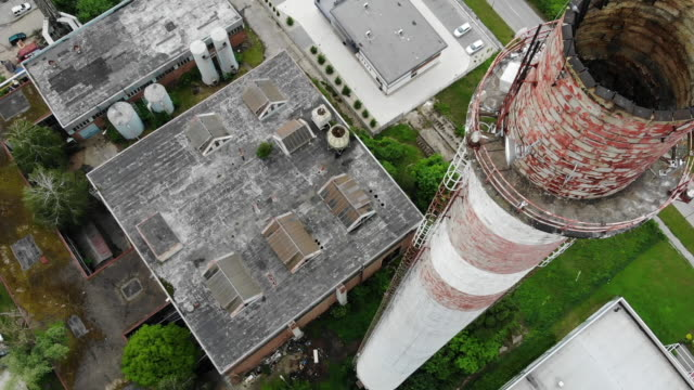 Exterior drone aerial shots of an industrial factory unit with tall brick chimney on 23 May 2019 in Bratislava Slovakia