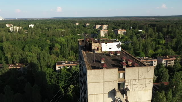 exterior drone aerial shots of the derelict former communist party headquarters on 11 june 2019 in pripyat ukraine - communist party stock videos and b-roll footage