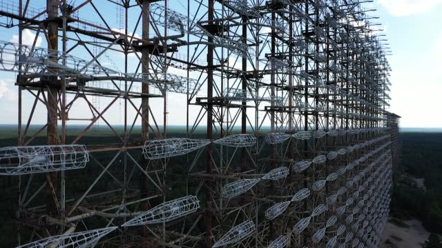 exterior drone aerial shots of the duga radar station, aka the 'russian woodpecker' on 11 june 2019 in chernobyl, ukraine - cold war stock videos & royalty-free footage
