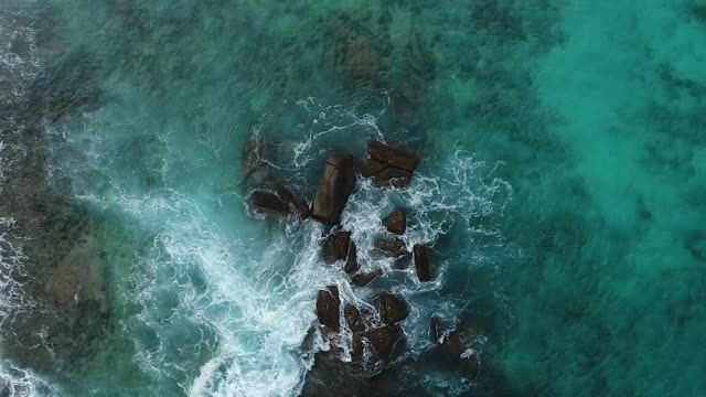 exterior drone aerial shots of waves crashing over rocks near a beach on 9 february 2019 in the seychelles - seychelles stock videos & royalty-free footage