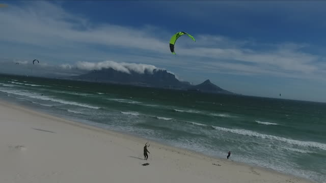 Exterior drone aerial shots over a Cape Town beach with Table Mountain in the background as kite surfers take to the waves on 7 March 2018 in Cape...