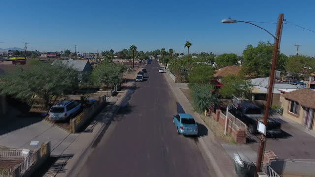 exterior drone aerial shots over a latino neighbourhood in west phoenix with various suburban houses, parked cars and roads on november 07, 2016 in... - latin american and hispanic ethnicity bildbanksvideor och videomaterial från bakom kulisserna