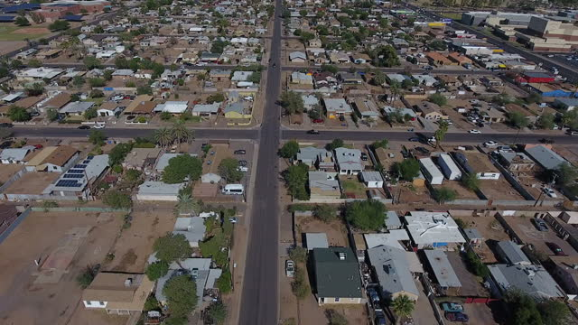exterior drone aerial shots over a latino neighbourhood in west phoenix with various suburban houses, parked cars and roads on november 07, 2016 in... - arizona stock videos & royalty-free footage