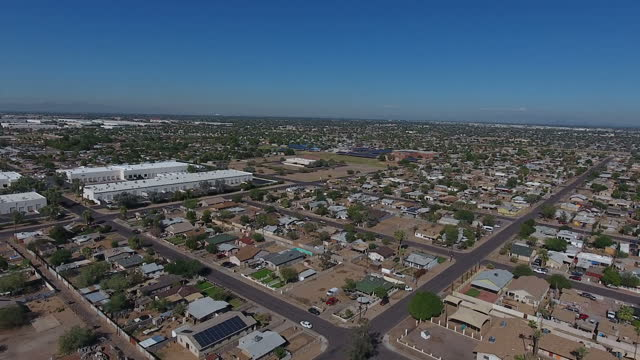 Exterior drone aerial shots over a Latino neighbourhood in West Phoenix with various suburban houses parked cars and roads on November 07 2016 in...