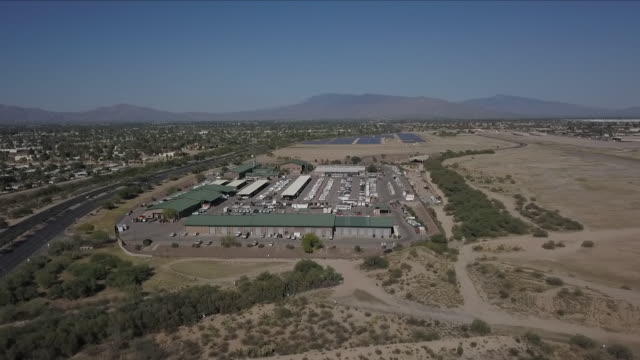 exterior drone aerial shots over an immigration detention facility near the mexican us border on 26 june 2018 in nogales, arizona, united states - border stock videos & royalty-free footage