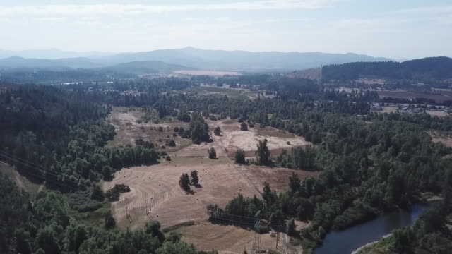 exterior drone aerial shots over mountains, forests, a river and farmland in the willamette valley, including woodland and a river on 19 october 2019... - eugene oregon stock videos & royalty-free footage