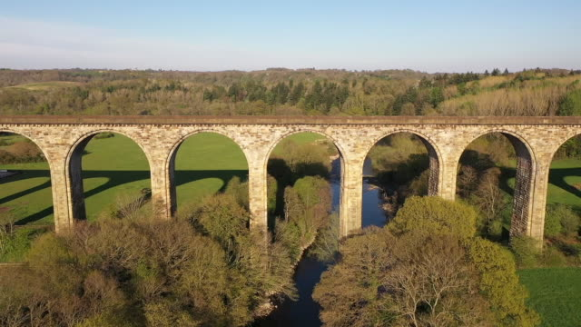exterior drone aerial shots over north wales countryside including a victorian railway viaduct on 5 may 2020 in conwy, wales, united kingdom - 19th century style stock videos & royalty-free footage