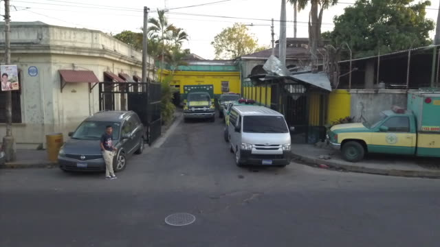 exterior drone aerial shots over san salvador city including the business district roads traffic a large cemetery mountains sunset and sunrise on... - gang stock videos and b-roll footage