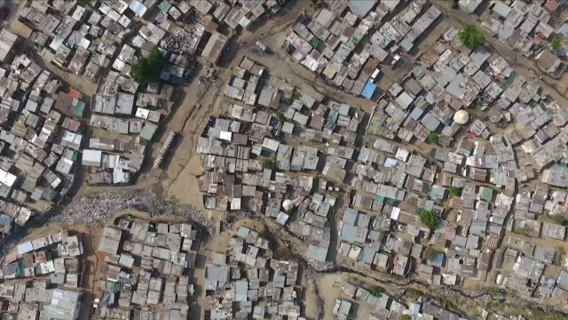 exterior drone aerial shots over the rooftops of diepsloot township with various shacks and permenant structures on 30 may 2018 in johannesburg,... - slum stock videos & royalty-free footage