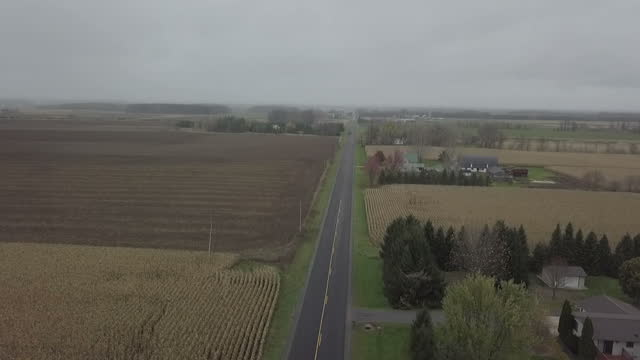 exterior drone aerial shots over wisconsin countryside and farmland along a rural road on 8 november 2017 in wisconsin united states - small town stock videos & royalty-free footage