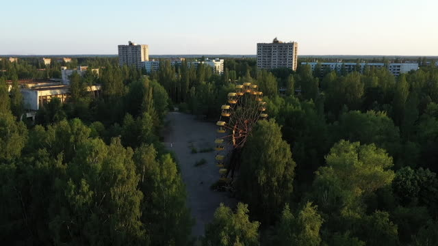exterior drone aerials around a derelict funfair with dilapidated ferris wheel and dodgem cars on 12 june 2019 in pripyat, ukraine - bumper car stock videos & royalty-free footage
