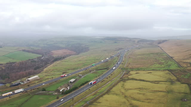 exterior drone aerials of a strech of the m62 motorway on the 26th november 2020 in west yorkshire, england - rural scene stock videos & royalty-free footage