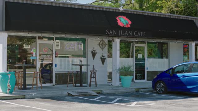 Exterior establishing shot of local restaurant San Juan Cafe offering Latin American cuisine.