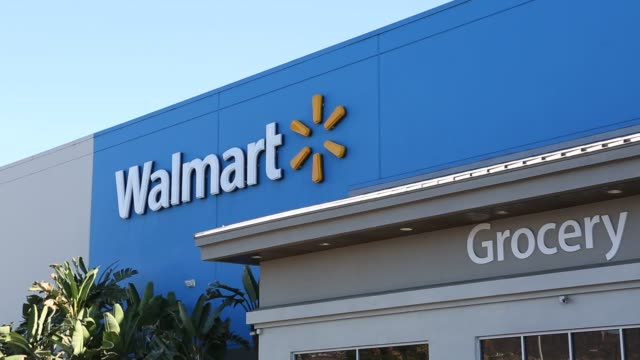 stockvideo's en b-roll-footage met exterior footage and signage at a walmart stores inc location in burbank california us on tuesday nov 22 shots wide shoth of entrance area to walmart... - wal mart