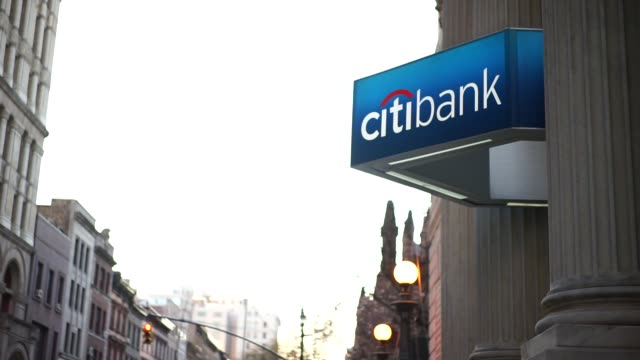Exterior footage of a Citibank on April 12 2016 in New York NY Shots tilt down to Citibank signage shot of entrance to citibank as people walk by...