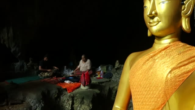 exterior general views of the cave system with holy shrine materials and buddhist statues and view of the inside of the cave on 5 july 2018 in chiang... - thailand stock videos & royalty-free footage