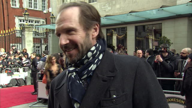 exterior grab ralph fiennes talking on empire awards red carpet about being involved in new jame bond film 'spectre' on march 29 2015 in london... - spectre 2015 film stock videos and b-roll footage