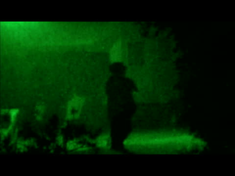 exterior green night vision shots of armed police gatherd in rothbury during raoul moat siege exterior green night vision shots of police activity... - confrontation stock videos and b-roll footage