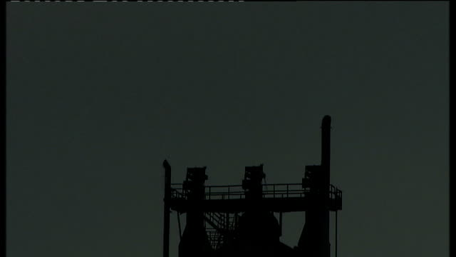 stockvideo's en b-roll-footage met exterior gvs of corus steel plant overcast various shots of towers and smoking chimneys silhouetted against grey sky various shots of sections of... - bare tree