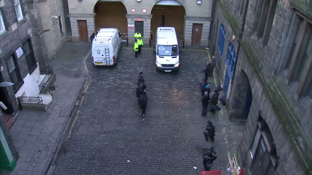 exterior high shot of police & prison vehicles leaving courtyard carrying rosdeep adekoya, the mother accused of murdering her 3 year old son mikaeel... - courtyard stock videos & royalty-free footage