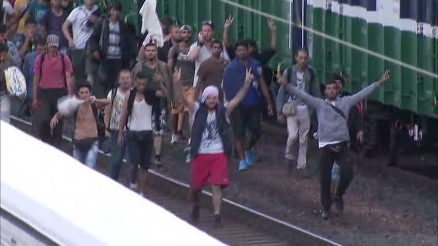 Exterior high shots crowd of migrants refugees asylum seekers walking along train tracks towards Austrian border on September 04 2015 in Bicske...