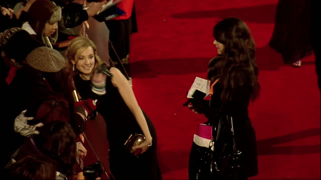 stockvideo's en b-roll-footage met exterior high shots downton abbey actress joanne froggart signs autographs for fans on the red carpet at the bafta arrivals joanne froggard on the... - signeren