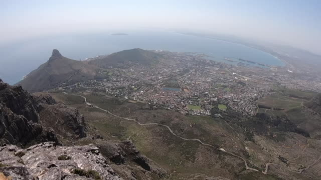 exterior high shots from table mountain over cape town and ocean on 24 september 2019 in cape town, south africa - テーブルマウンテン国立公園点の映像素材/bロール