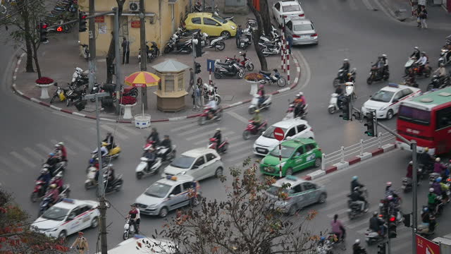 Exterior high shots of busy traffic in Hanoi city centre and skyscrapers of the central business district in the background on February 23 2015 in...