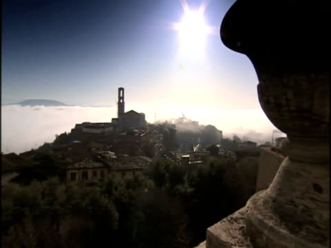 exterior high shots of perugia. exterior two students sat on steps of unidentified building. exterior shots of perugia rooftops. meredith kercher... - perugia stock videos & royalty-free footage