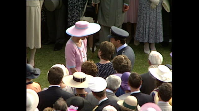 CLEAN exterior high shots of Prince Philip Duke of Edinburgh and shots of Diana Princess of Wales walking around Buckingham Palace Garden Party...