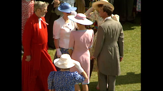exterior high shots of princess diana princess of wales walking around garden party talking to guests on july 11 1991 at buckingham palace in london... - königin stock-videos und b-roll-filmmaterial