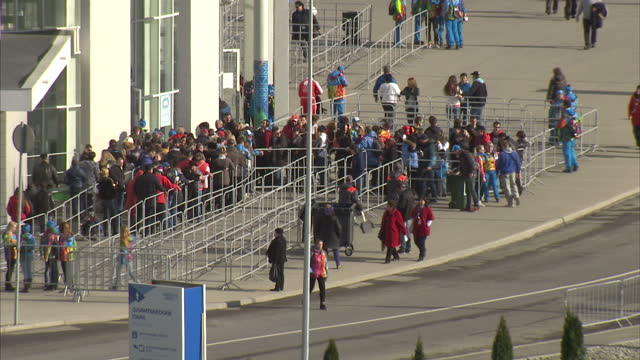 exterior high shots of trains and passengers arriving at the sochi olympic park railway station>> on february 05 2014 in sochi russia - bahnreisender stock-videos und b-roll-filmmaterial