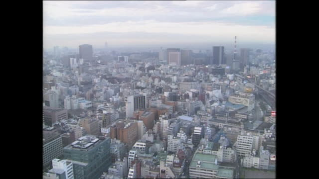 exterior high shots over tokyo's city skyline including bullet trains passing along tracks and city skyscrapers on 30 september 1989 in tokyo, japan - tokyo japan stock videos & royalty-free footage