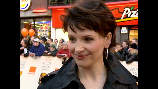 exterior interview juliette binoche actor on red carpet at the bafta awards talking about being nominated for a bafta for her role in chocolat on... - british academy television awards stock videos & royalty-free footage