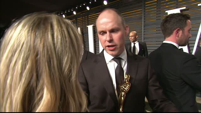 exterior interview paul franklin holding oscar on february 22 2015 in los angeles california - vanity fair oscar party stock videos & royalty-free footage