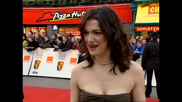 exterior interview rachel weisz actress on red carpet at the bafta awards talking about her favourite film of the year and holding the baftas before... - rachel weisz stock videos & royalty-free footage