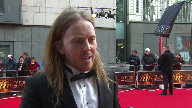 Exterior interview Tim Minchin speaks on his role as writer for the musical 'Matilda' on the red carpet at the Laurence Olivier Awards Tim Minchin on...