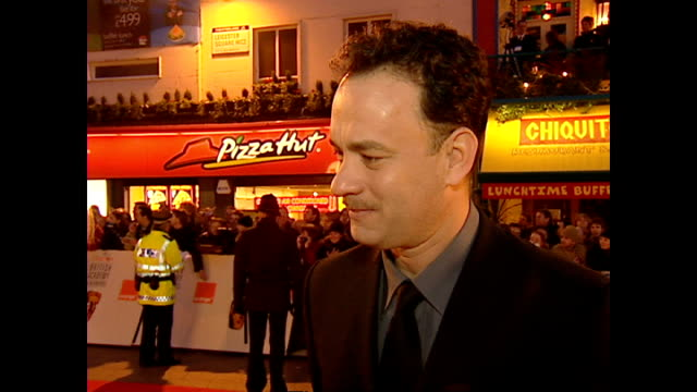 exterior interview tom hanks actor on red carpet at the bafta awards talking about losing weight for his bafta nominated role in cast away on... - british academy television awards stock videos & royalty-free footage